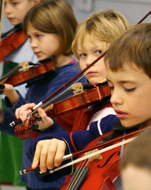 In the third grade, and sometimes the fourth, most children take up a stringed instrument, typically the violin or perhaps the cello.